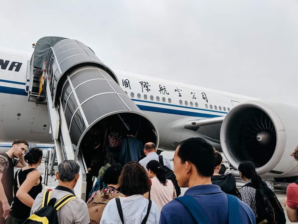 Chinese passengers board Air China flight